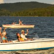 Group of friends racing with motorboats - Stock Photo