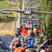 Couple hugging on romantic chairlift trip — Stock Photo