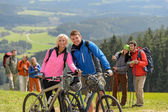 Sporty cyclist couple hikers springtime weekend — Stock Photo