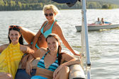 Young women sunbathing on boat — Stock Photo