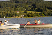 Young friends having fun in motorboats — Stock Photo