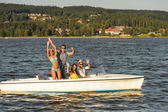 Young friends enjoying summer on speed boat — Stock Photo