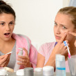 Young teenagers with acne problem in bathroom — Stock Photo