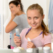 Two young sisters getting ready in bathroom — Stock Photo