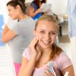 Stock Photo: Teenage girl cleaning face with cotton pad