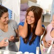 Three laughing teenager girls talking in bathroom — Stock Photo #23407864