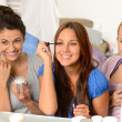 Three teenager girls getting ready in bathroom - Stok fotoğraf