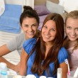 Three young girl friends posing in bathroom — Stock Photo