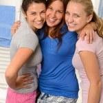 Three teenage girls laughing in pajamas — Stock Photo