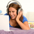 Young girl watching movie on laptop — Stock Photo #23408072