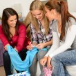 Young excited girls after shopping spree - Stock Photo
