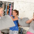 Stock Photo: Young laughing girls during pillow fight