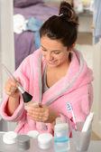 Teenager girl applying make-up powder with brush — Stock Photo