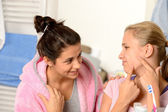 Teenage girls having acne problems in bathroom — Stock Photo