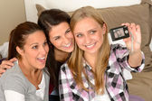 Smiling young girls taking self portrait — Stock Photo