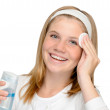 Young cheerful girl removing make-up cleansing pad — Stock Photo #23750879