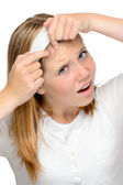 Teenager girl squeezing pimple skin problems spot — Stock Photo