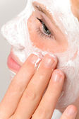 Applying mask fingers young girl beauty skin — Foto de Stock