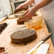 Cook taking out cake from cake form - Foto de Stock