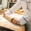 Cook rolling dough kitchen with rolling pin - Foto de Stock