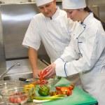 Cooks preparing salad in restaurant's kitchen — Stock Photo