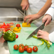 Close up of chefs cutting vegetables — Stock Photo