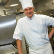 Male chef posing in commercial kitchen — Stock Photo