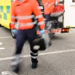 Blurry paramedics getting out from ambulance car - Stock Photo