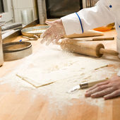 Chef pouring flour dough and rolling pin — Stock Photo