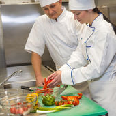 Cooks preparing salad in restaurant's kitchen — Stok fotoğraf