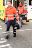 Blurry paramedics getting out from ambulance car — Stock Photo