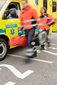 Rushing blurry paramedic unit portable devices truck — Stock Photo