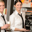 Cheerful waitresses serving hot coffee in bar — Stock Photo #24956941