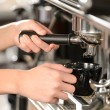 Close up making coffee cappuccino with machine - Stock Photo