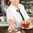 Attractive waitress taking tip in bar CZK — Stock Photo