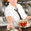 Attractive waitress taking tip in bar USD — Stock Photo #24957009