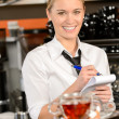 Smiling waitress taking order in coffee house — Stock Photo