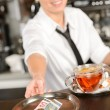 Attractive waitress taking tip in bar EUR — Stock Photo