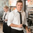 Handsome waiter making coffee espresso machine — Stok Fotoğraf #24957113