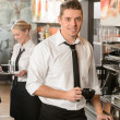 Handsome waiter making coffee espresso machine — Stok fotoğraf
