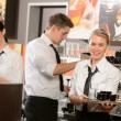 Confident waitresses and waiter working in bar — Stok fotoğraf