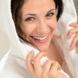 Cheerful smiling woman in white bathrobe — Stock Photo