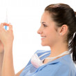 Woman nurse with syringe in blue uniform — Stockfoto