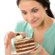 Tempting sweet cake and young hungry woman — 图库照片 #24957989
