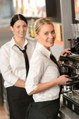 Smiling young waitresses serving coffee restaurant — Stock Photo