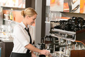 Waitress preparing hot beverage in coffee house — Stock Photo