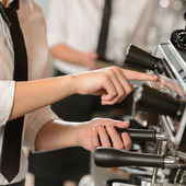 Waitress operating espresso machine coffee house — Stock Photo