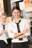 Confident waitress posing in cafe — Stock Photo