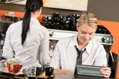 Happy waitresses working at cafe in uniform — Stock Photo