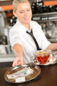 Attractive waitress taking tip in bar USD — Stock Photo